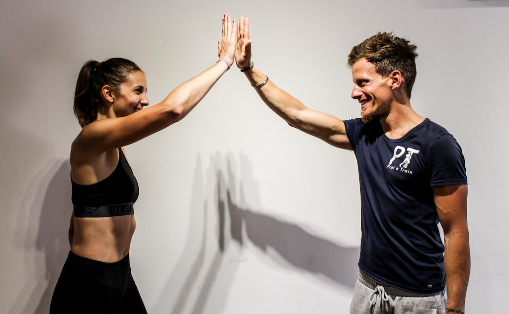 Personal trainer in South london Pret-a-Train with client